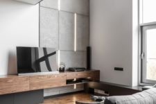 26 concrete tiles and wooden touches make this manly living room more textural