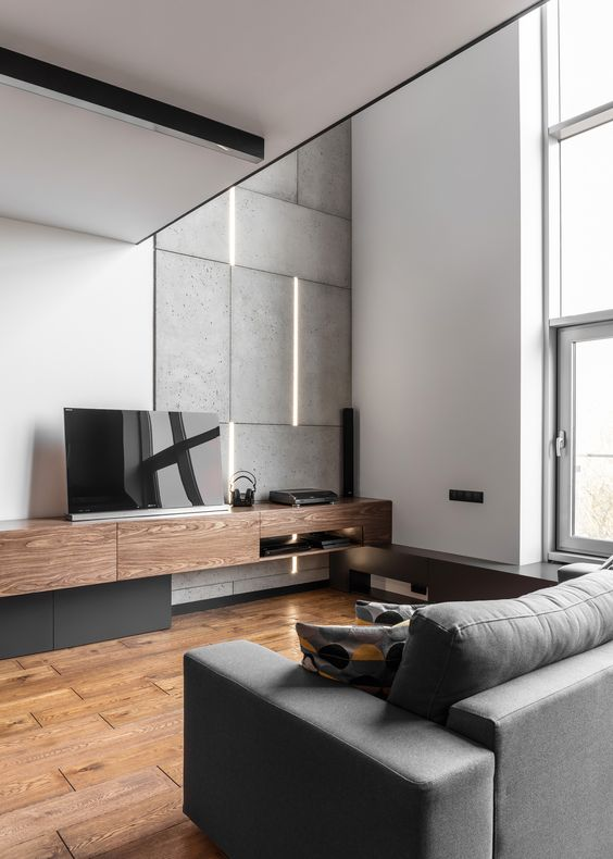 concrete tiles and wooden touches make this manly living room more textural
