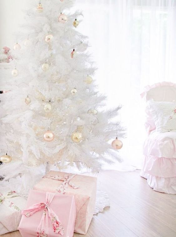 a pure white Christmas tree with pastel ornaments will bring a vintage glam feel to your space