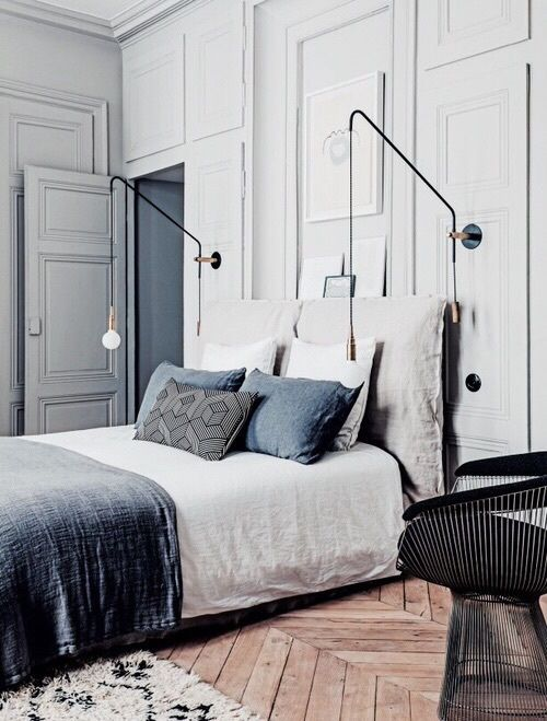 11-a-comfy-matte-grey-wall-sconce-that-can-be-rotated-in-different-ways-for-comfy-using 27 Chic Bedroom Sconces In Different Styles