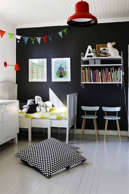 refresh a black statement wall with artworks and books to make it cooler