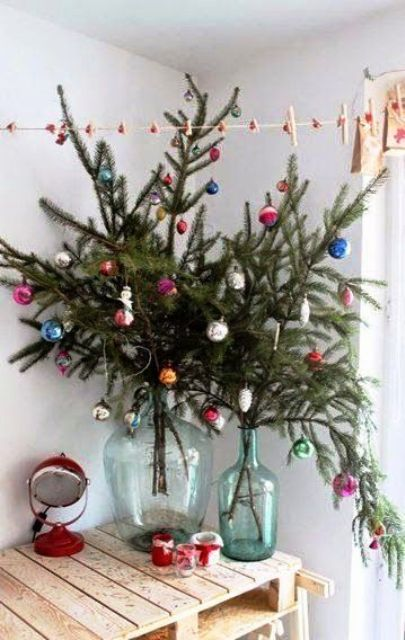 some evergreen branches with colorful vintage ornaments as an alternative to a Christmas tree