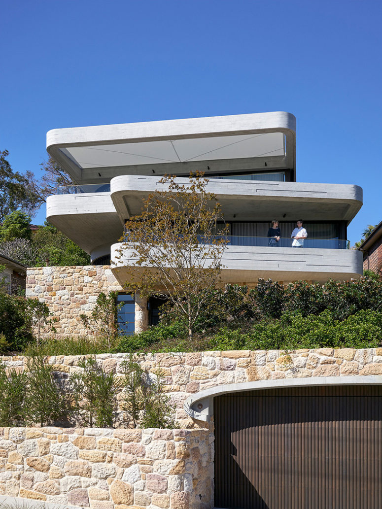 Books House is a chic concrete slab and snadstone home on a side of Sydney's harbor