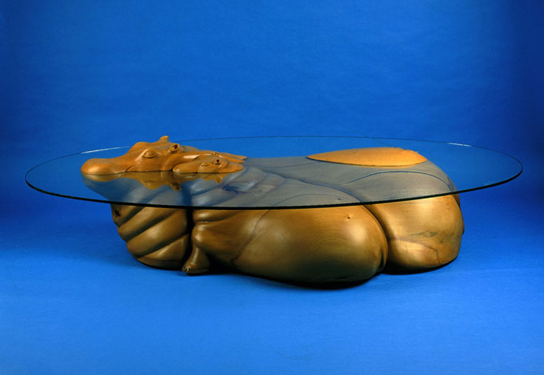 Hippo Table is part of the collection called Water Tables, which portrays various animals and even people in the water