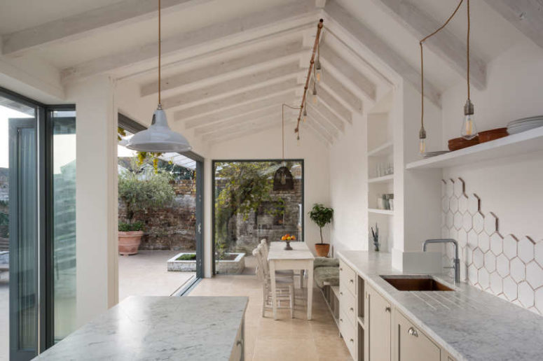 01-This-airy-white-kitchen-and-dining-zone-is-opened-to-outdoors-as-much-as-possible-and-feels-very-light-and-airy-775x516 Airy White Kitchen With Various Textural Touches