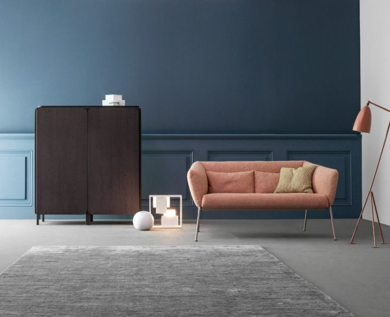 This dark sideboard is a part of the Frame Sideboard collection and it's done in the same colors