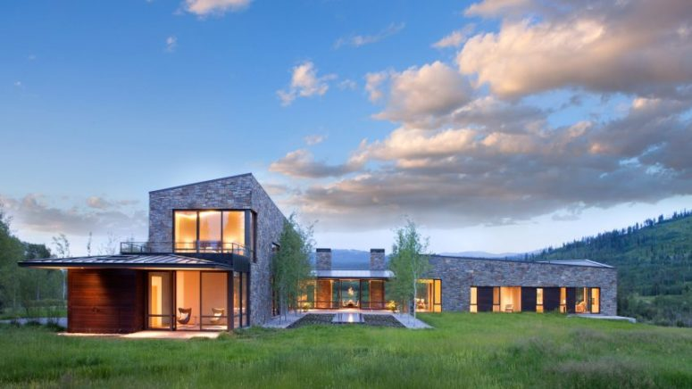 This large Wyoming residence is clad with stone and wood features amazing views of the beautiful nature around