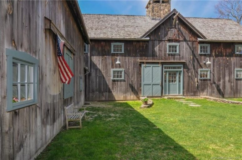 This unique home is made of two old barns transported to the property