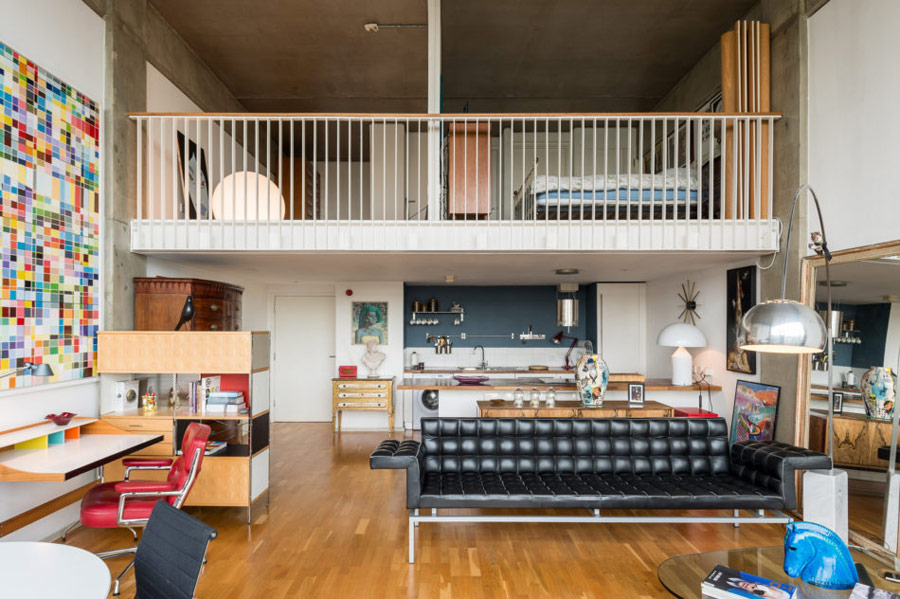 There are two levels, the upper is with private spaces, and the lower one is an open plan space with a kitchen, dining and living room