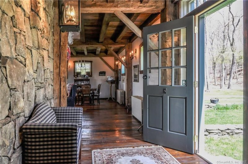Upon entry you see much wood and natural stone that are the main materials used for decor