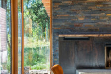 02 Wood, stone, blackened metal and leather are widely used throughout the house and create that cabin feel