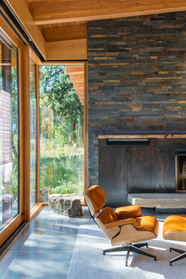 Wood, stone, blackened metal and leather are widely used throughout the house and create that cabin feel