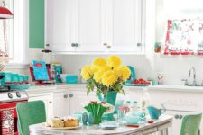 02 a bold green accent wall, matching chairs, a red cooker and turquoise touches ehre and there