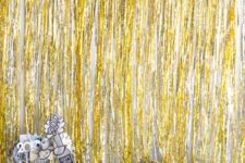02 a bold photo booth in black, gold and silver with fringe and props