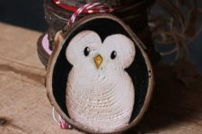 02 a cute wood slice penguin ornament is a great idea and is easy to paint yourself