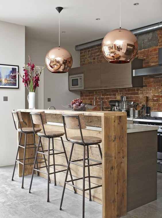 large copper bubble lamps soften the space and make a glam statement