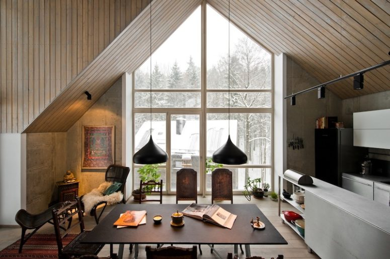 Attic wooden ceilings and large windows make the guests feel like in a countryside house