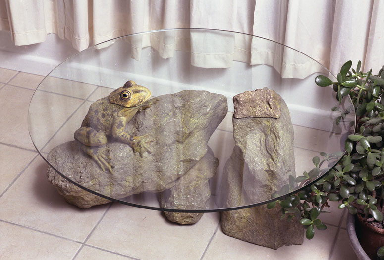The Frog Table shows a frog sitting on a stone, looks very natural