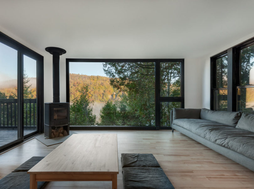 The living room is connected to this zone, it features much glazing and simple furnishings plus a metal hearth