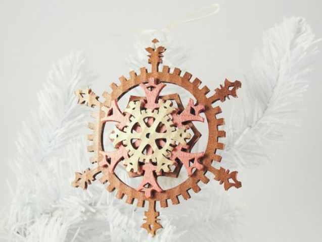 a colorful felt gear snowflake ornament for Christmas