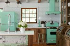 03 a mint fridge, a cooker and a hood give this rustic kitchen a retro feel