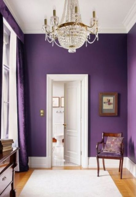 a violet statement wall and violet velvet curtains for a refined entryway