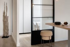 03 light-colored wood, cork, metal and a black glass sliding door