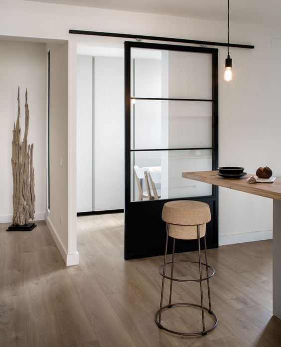 light-colored wood, cork, metal and a black glass sliding door