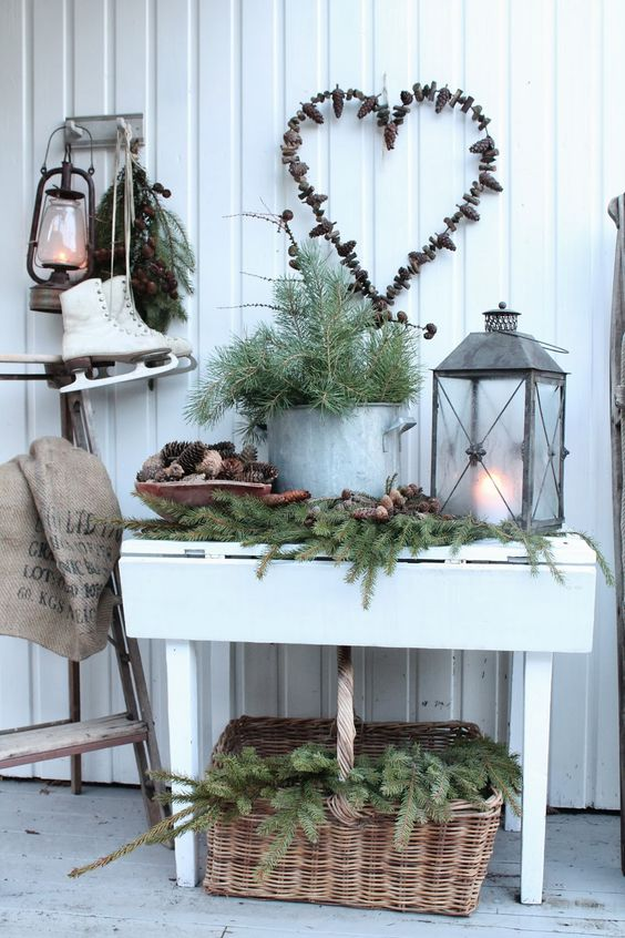 lush evergreens with pinecones, evergreens in a pot and a candle lantern