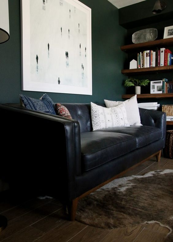 a black leather sofa is classics that will fit many interiors