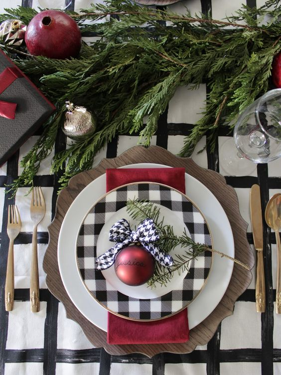 a plaid plate and a wooden charger can make up a cool setup for Christmas