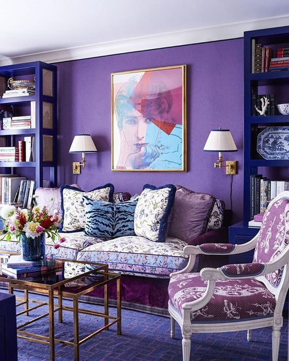 a violet statement wall and a geometric print rug in a refined space
