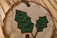 04 wood burnt and painted mistletoe wood slice ornaments with a strong rustic feel
