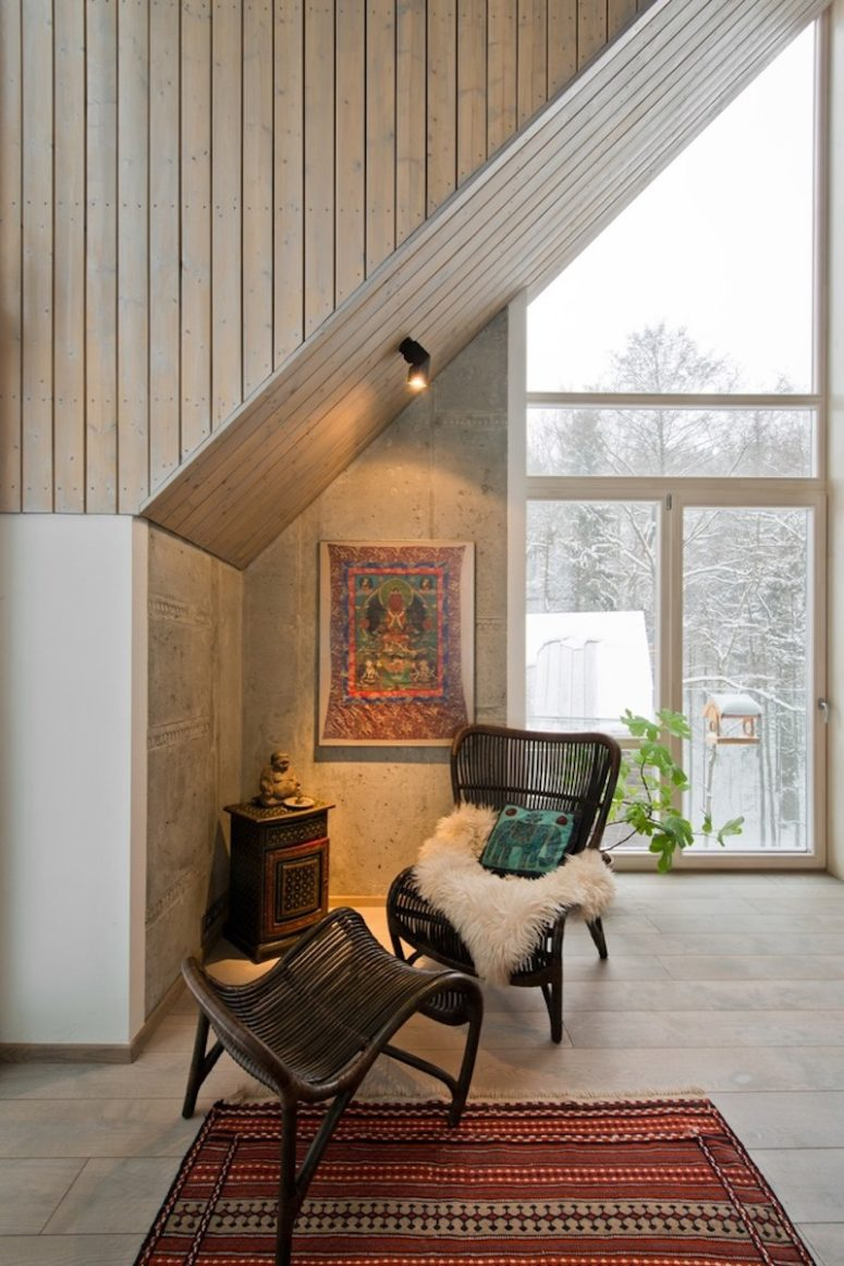 There's a comfy reading nook with a wicker chair and a boho rug