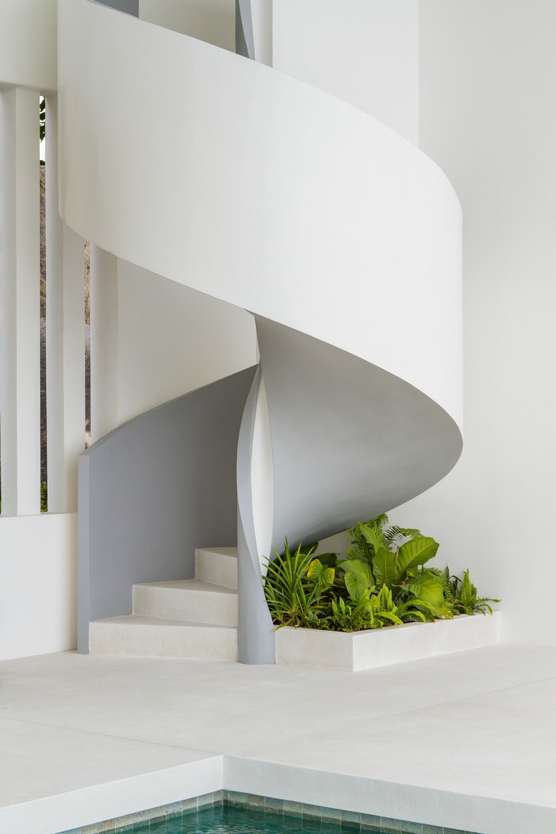 Under the sculptural staircase you'll see fresh greenery growing