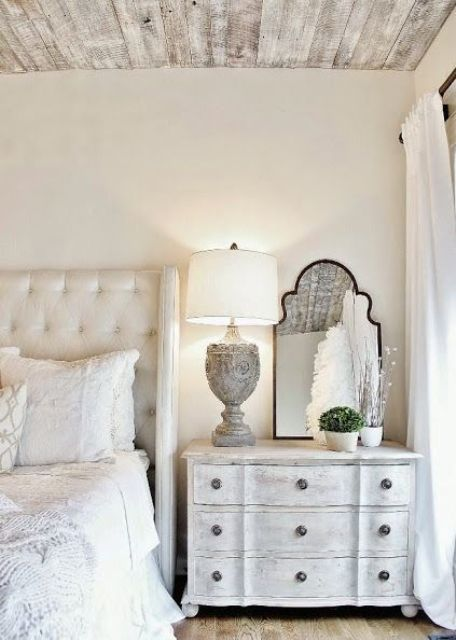 a Provence bedroom can be completed with a whitewashed dresser of a vintage look