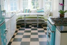 05 a turquoise fridge, hood and cooker and a diner-inspired eating zone make the space retro