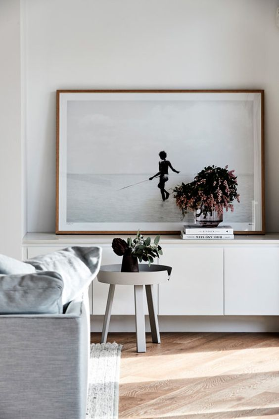 this artpiece is placed on the ikea-like sideboard and it is slightly shorter, so it looks harmonious