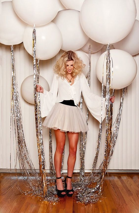white balloons with silver fringe are sure to make your photo booth or other space awesome
