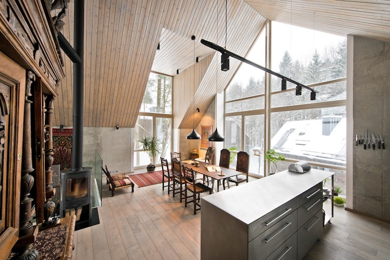 A hearth in the kitchen dining zone adds coziness to the space