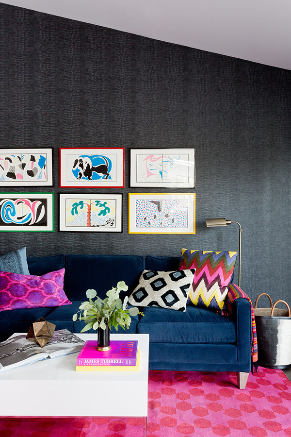 The second living room shows off bold furniture and textiles and artworks