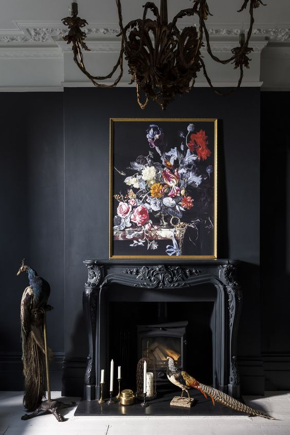 hanging an artwork over the mantel or placing it right on it is a traditional idea