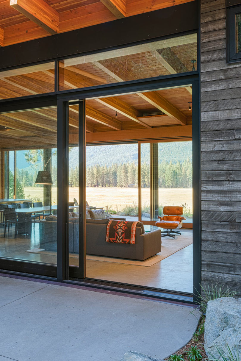 Extensive glazing helps the indoor spaces merge with the terraces outdoors that seem to extend the rooms outside