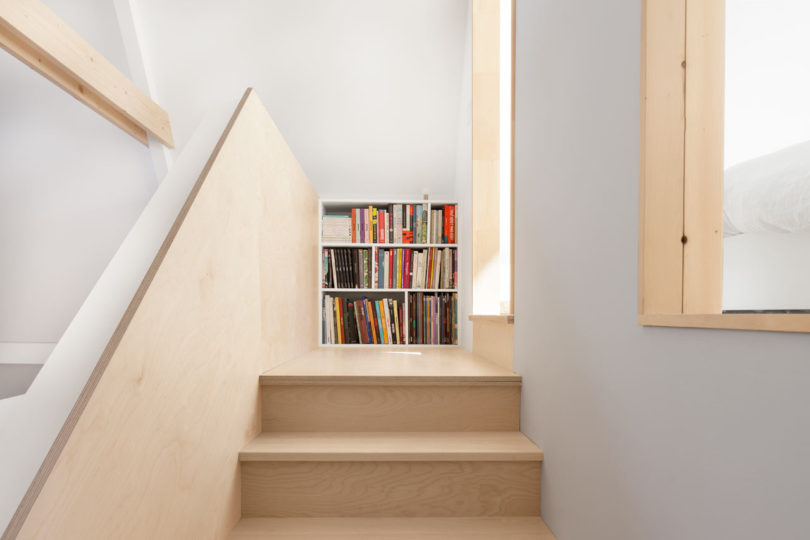 The end of the stairs is a bookcase, the designers got maximum of the space