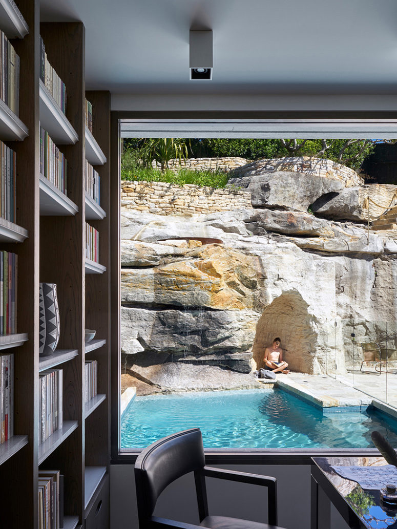 The study has the views of a small pool and a cave made in the rock for meditation