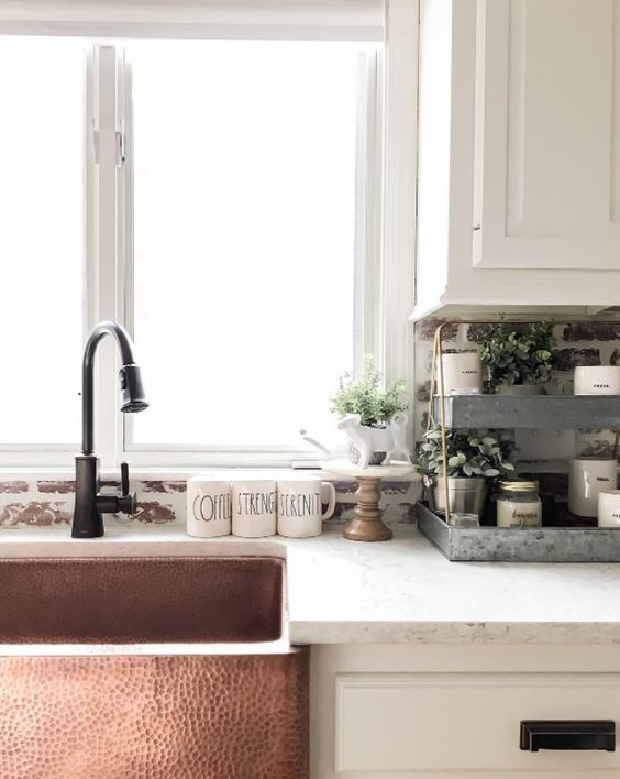 a hammered copper sink will bring a refined vintage feel to your kitchen