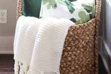 07 a large basket with blankets and pillows is ideal for a bedroom