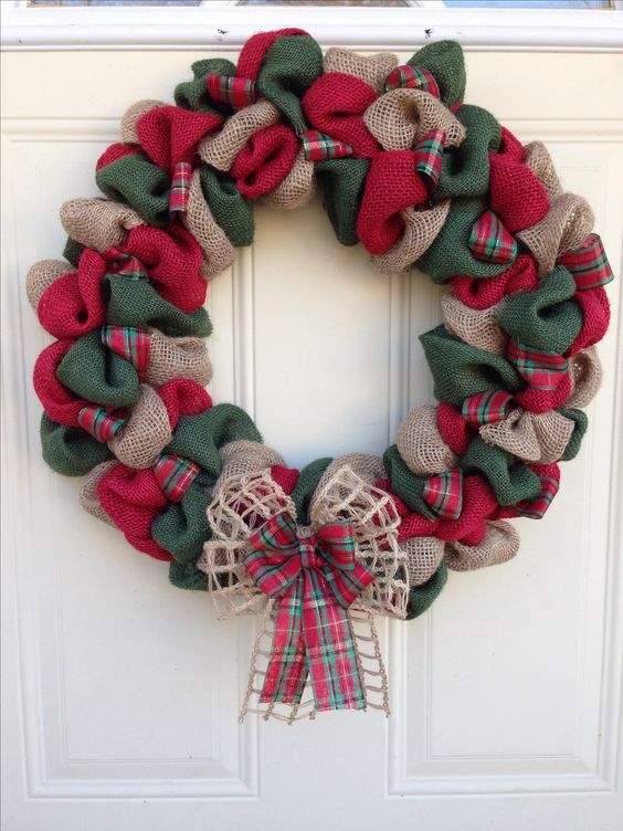 a traditional red, green and neutral burlap wreath with a double bow for a front door
