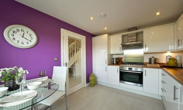 add a trendy feel to your kitchen making a violet statement wall