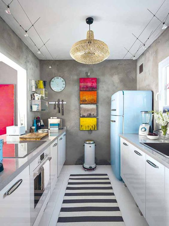 add touches of color with artworks and a bold fridge, for example, Smeg
